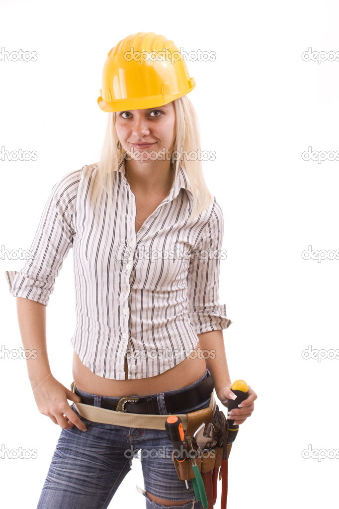Sexy construction worker with tool bag and a lot of equipment suspenders a jeans — Stock Photo #6872128