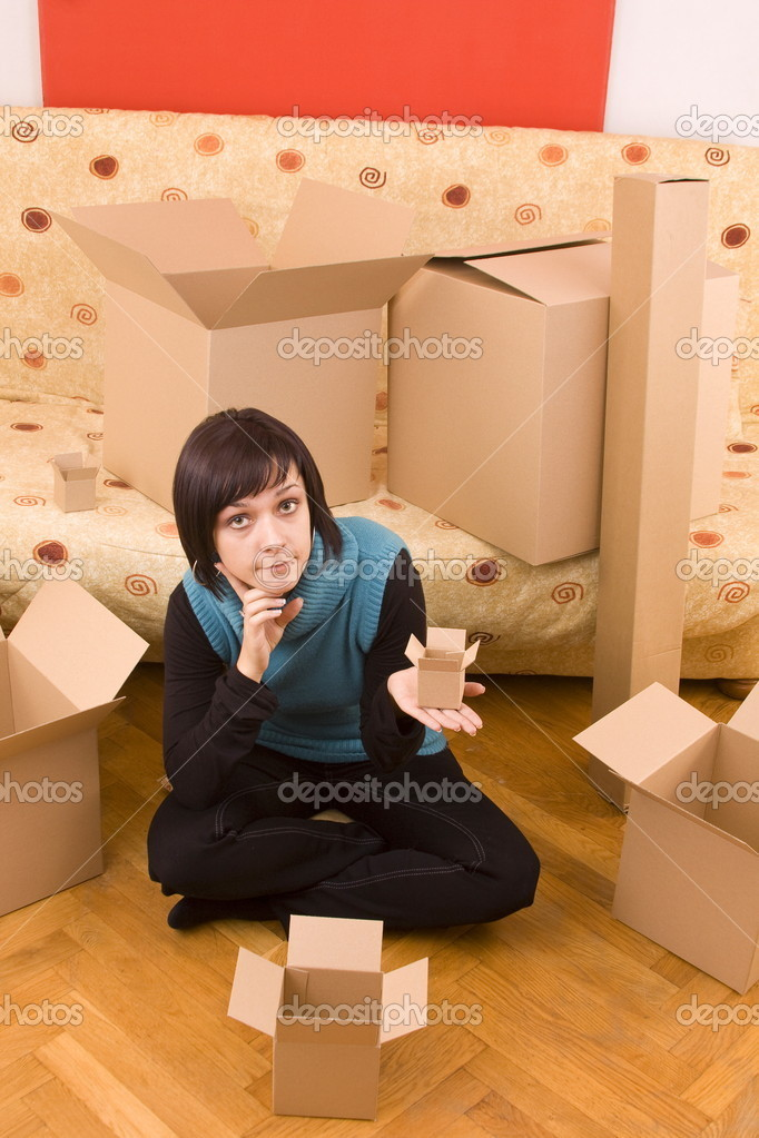 Attractive woman looking for the little box — Stock Photo #6872265