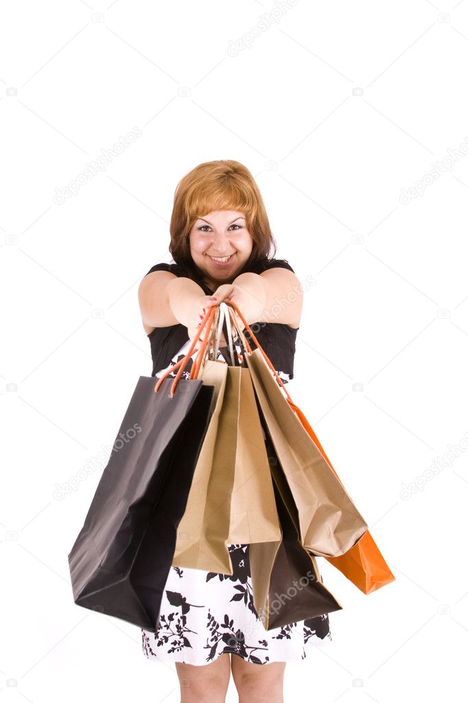 Portrait of an young woman holding several shoppingbag  — Stock Photo #6872802
