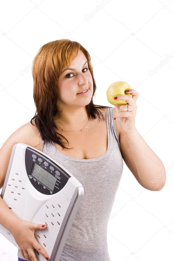 Young woman eating apple and carrying a weight scale over white background  — Stock Photo #6872812