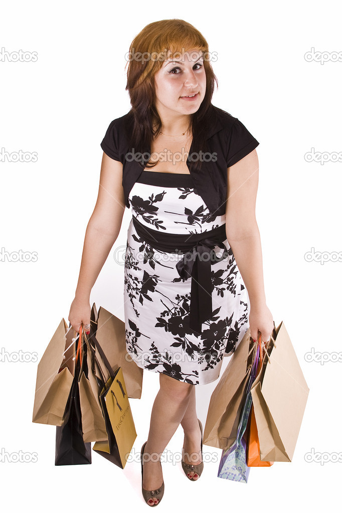 Lovely woman with shopping bags over white  — Stock Photo #6872820