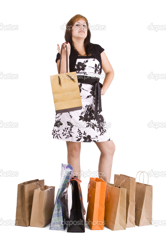 Lovely woman with shopping bags over white  — Stock Photo #6872845