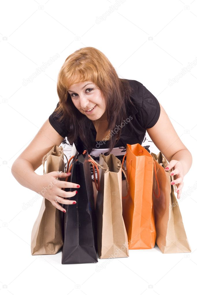 Lovely woman with shopping bags over white  — Stock Photo #6872856