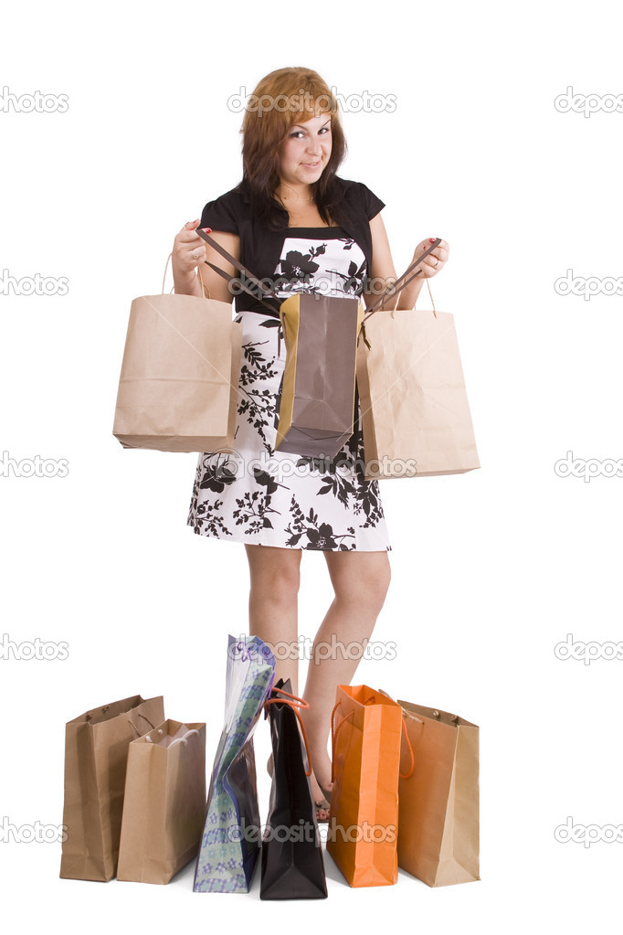 Lovely woman with shopping bags over white   Stock Photo #6872902