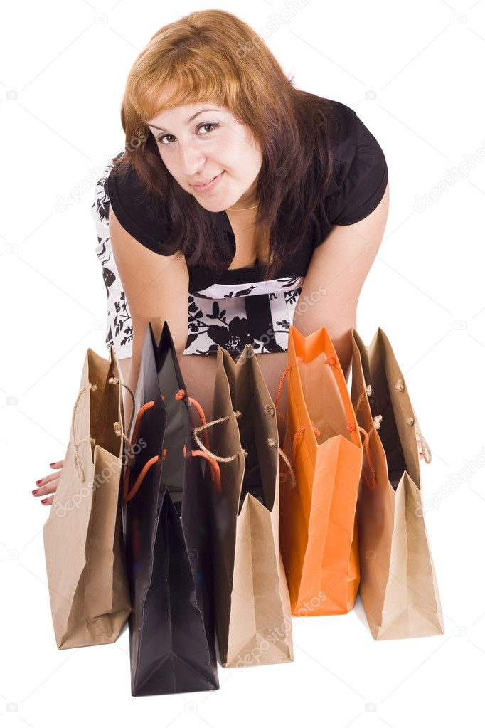 Lovely woman with shopping bags over white   Stock Photo #6872916