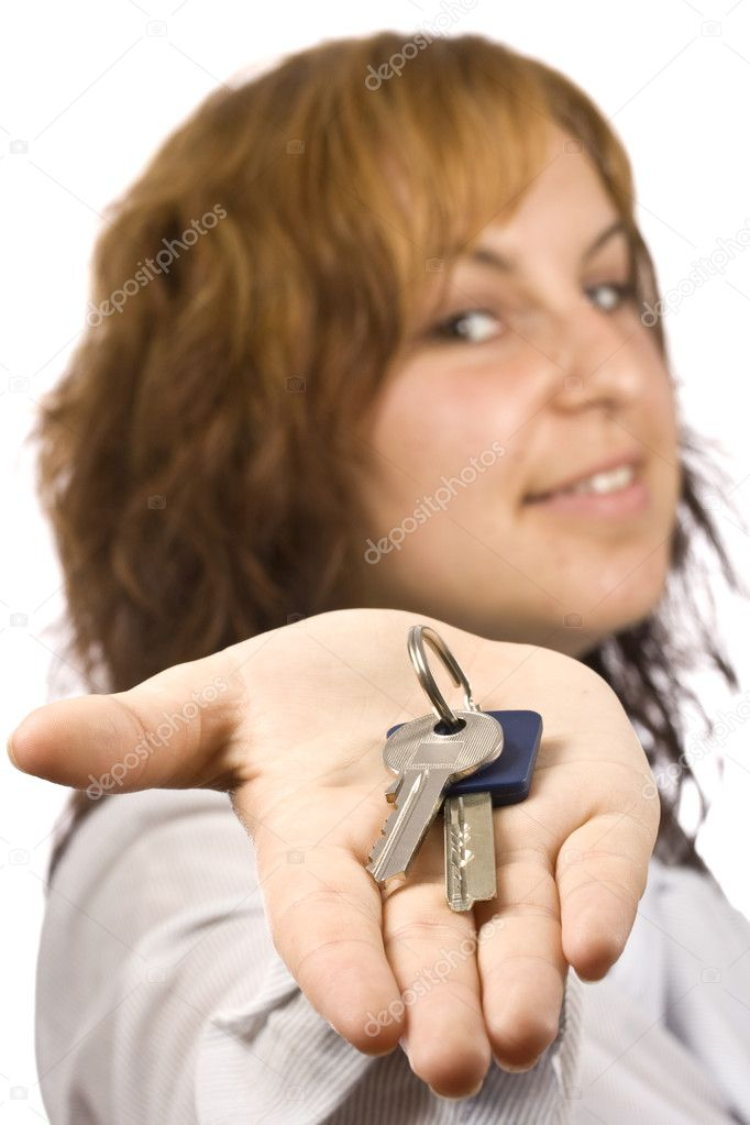 Portrait of businesswoman showing key in her palms, focus on the key  Stock Photo #6873081