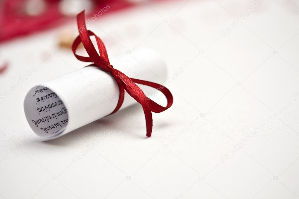 Wedding rolled paper with red ribbon  Stock Photo #6873238