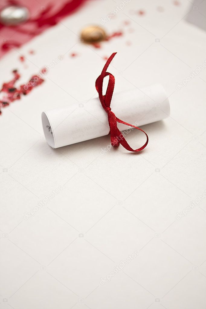 Wedding rolled paper with red ribbon — Stock Photo #6873243