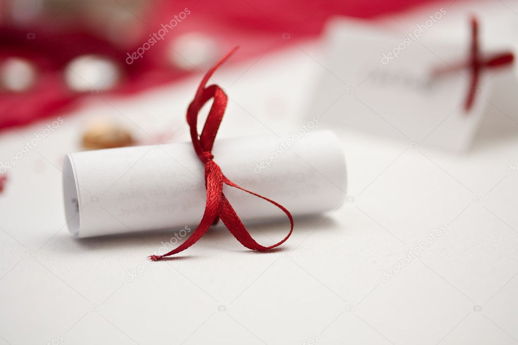 Wedding rolled paper with red ribbon — Foto de Stock   #6873245