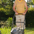 Man mowing the lawn — Stock Photo #7515283