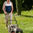 Man mowing the lawn — Stock Photo