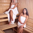 Two women enjoying a hot sauna — Stock Photo #7516053