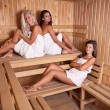 Three women enjoying a hot sauna — Stock Photo #7516064