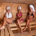 Three women relaxing a hot sauna — Stock Photo