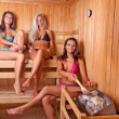 Friends using sauna — Foto Stock
