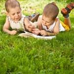 Boys reads a book — Stock Photo