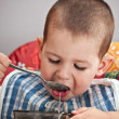 Child eating soup — Stock Photo
