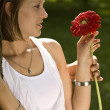 Giving a red flower — Stock Photo