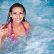 Young beautiful woman in jacuzzi — Stock Photo