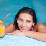 Young beautiful woman in water — Stock Photo