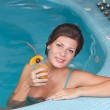 Woman enjoying vitamin drinks in jacuzzi — Stock Photo #7517757
