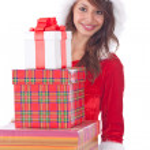 Miss Santa with gift box — Stock Photo