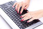Woman hands working on computer keyboard — Stok fotoğraf