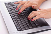 Woman hands working on computer keyboard — Stock Photo