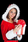 Miss Santa opening a gift box — Stock Photo
