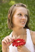 Woman holding a red flower — Stock Photo