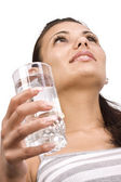 Woman with glass of water — Stockfoto