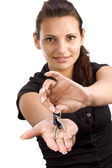 Woman showing key — Stock Photo