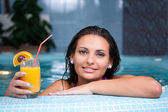 Young beautiful woman in jacuzzi — Stockfoto