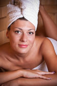 Woman relaxing in the sauna — Stock Photo