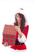 Miss Santa opening a gift box — Stock Photo
