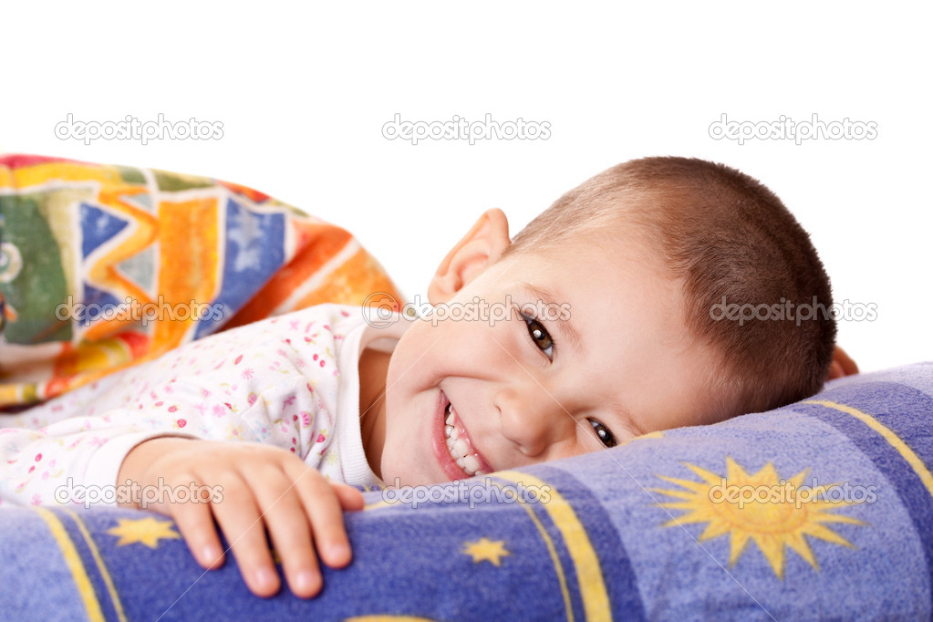 Little smiling boy is lying in bed  Stock Photo #7516397