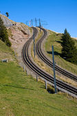 Railroad tracks in the alps — Stock Photo