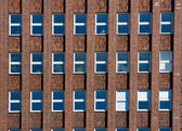 Facade of an old red brick building — Stock Photo