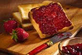 Toast with cherry jam — Stock Photo