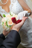 Groom gives to bride a gold ring — Stock Photo