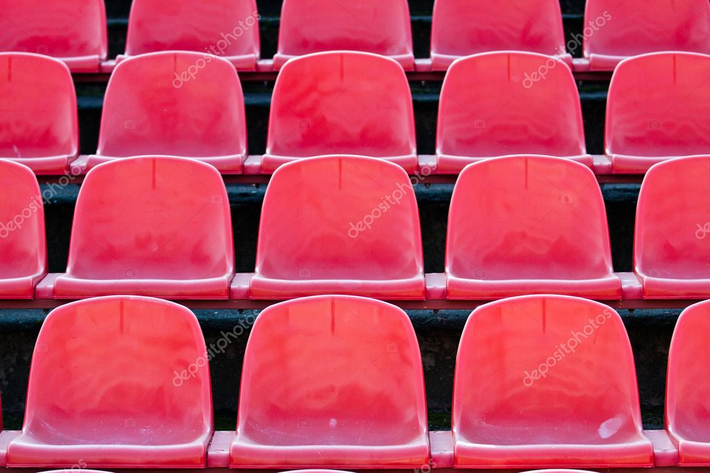 Many red sits on tha stadium, sports background. — Stock Photo #7174560