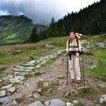 Backpacker girl exploring the mountains. — Stock Photo #7272860