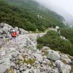 Backpacker girl exploring the mountains. — Stock Photo #7330177