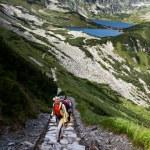 Backpacker girl exploring the mountains. — Stock Photo #7366269