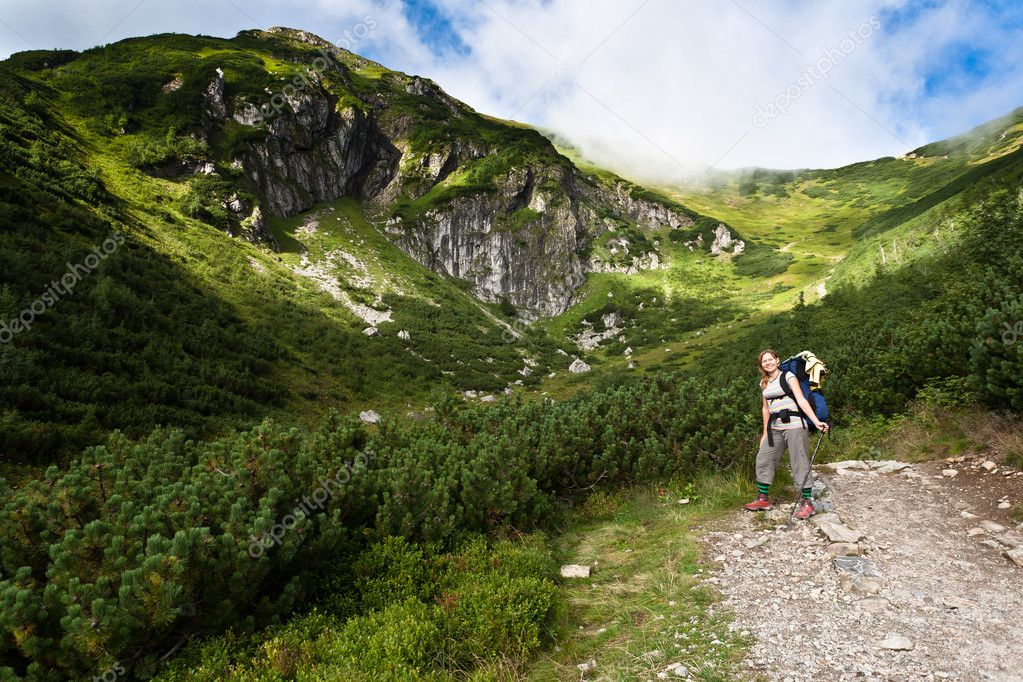 Backpacker girl tourist exploring the Tatra mountains national park, Poland.  Stock Photo #7376693