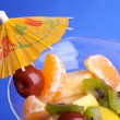 Fruit Salad 0n Blue Background - Lizenzfreies Foto