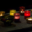 Glowing Candles In The Darkness — Stock Photo #7824064