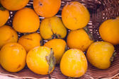 Persimmon in your shopping cart — Stock Photo