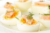 Boiled eggs with salted salmon — Stock Photo
