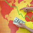 Stock Photo: World economic crisis - money in hand